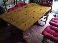 Pine Dining Table. Seats 6 comfortably. Well loved. Very strong and sturdy.