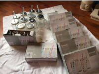 32 milk jugs and 11 drinking jugs