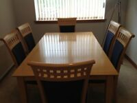 Dining table and six chairs.Immaculate condition,