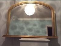Gold framed mirror , in good condition