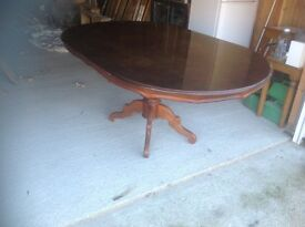 Highly polished dining table in dark wood
