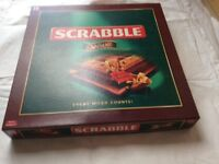 Deluxe Scrabble set, never been played with, in mint condition, great game for adults.