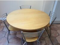 Cafe style circular table with four chairs