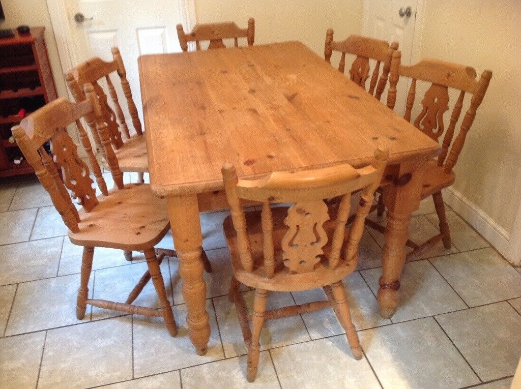 large farmhouse kitchen table with six matching chairs