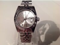 Rolex- Day date– Ladies –stainless steel – silver face