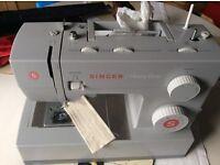Heavy duty singer sewing machine.