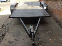 Twin axle flatbed trailer.