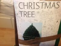 6ft Articicial Christmas tree (Monterey Spruce). Bushy tree in v good condition.