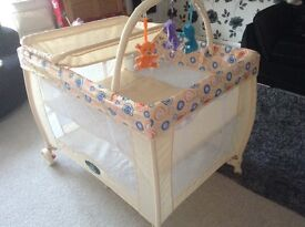 Travel cot with changing facility and mobile