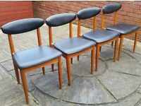 4 schreiber dining chairs. wooden frame with black paded seats. In good condition.