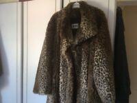 Long length fur coat