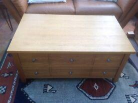 Next storage unit with drawers.
