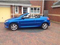 Fabulous 2005. Peugeot 206 cc Electric Blue with White Leather Upholstery