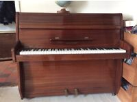 Here is a Zender Upright piano.A compact model made in Mahogany case with brass fittings.
