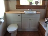 Complete bathroom unit with sink and toilet, excellent condition