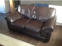 Three seater and two seater dark brown leather sofas and matching pouffee for sale