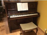 Piano. Made by C.E.Little of London. Good Condition. Attractive Inlay above Keys.