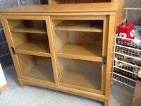 light coloured wood veneered glass fronted cabinet