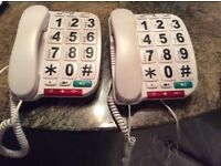Telephones with large numbers, white in good working order