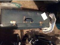 Old suitcase, still has keys for locks.
