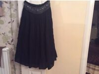 Modern lined autumn and winter black gypsy skirt