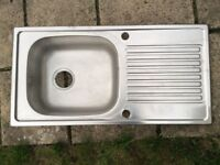 Stainless steel sink unit.