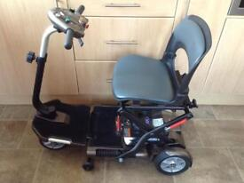 TGA MINIMO COMPACT / FOLDING MOBILITY SCOOTER WITH ARMS IN STUNNING CONDITION.