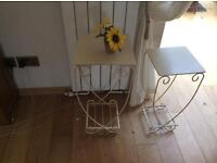 Two cream side tables