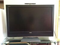 "42"" Toshiba TV with remote control"