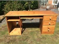 Double fronted solid pine desk, file drawer and two sliding drawers
