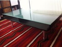 Black solid wood coffee table glass topped 120*65* 35cm in a very good conditions