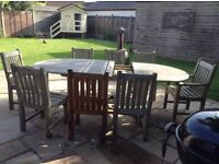 Hard wood garden table and 8 chairs