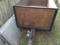 Metal framed wooden trailer with detachable back. Recently refurbished