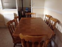 Dinning table and chairs light teak.