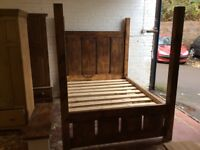 King size four poster bed.