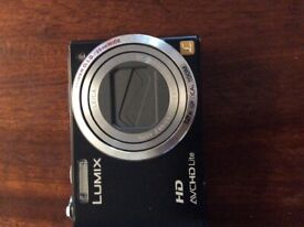 PANASONIC DMC-TZ10 LUMIX CAMERA WITH LEICA LENS, WITH BATTERY CHARGER AND CARRYING CASE