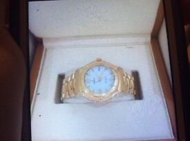 18kt gold and diamond Ebel gents or lady's watch,as new, Would make an amazing gift