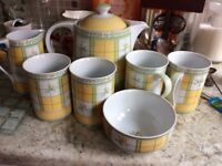 Teapot, milk jug, sugar bowl and four mugs in Marks and Spencer Yellow Rose