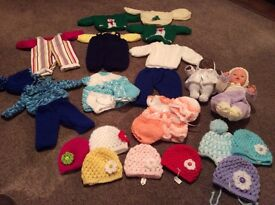 Selection of new hand knitted dolls clothes & dolls . Prices in description