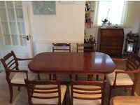 Rosewood, French style dinning table & six chairs.