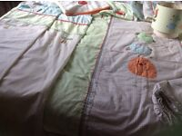 Nursery curtains and matching bedding and lampshade
