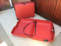 Two large Red Samsonite American Tourister Ridged Suitcases. Approx 28 x 21 x 8 inches;