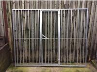 Galvanised panel with lockable gate