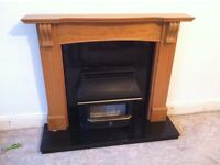 Oak effect wood fire surround with marble back panel & hearth.