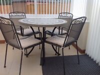 Conservatory / patio dining set comprising of table and four chairs