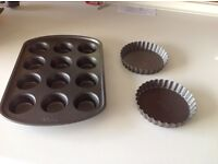 Three brand new items . Nonstick cake tray and two mini flan tins