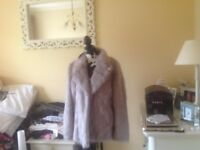 Fake fur jacket, silver gray size 16 brand new with tags.