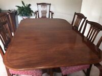 Extendable walnut dining table with 6 chairs