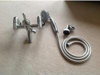 Polished chrome taps with shower head and attachments
