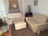 2 x Two Seater Cream Leather Sofa and Large Poufee (2years old)
